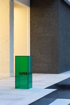 Seoul-based Creative Studio Unravel has designed the interior of 'Super Matcha'—an intriguing, minimalist space for contemplation and the enjoyment of matcha green tea in a. Wayfinding Signage, Signage Design, Branding Design, Identity Branding, Corporate Design, Visual Identity, Web Banner Design, Creative Studio, Environmental Graphics