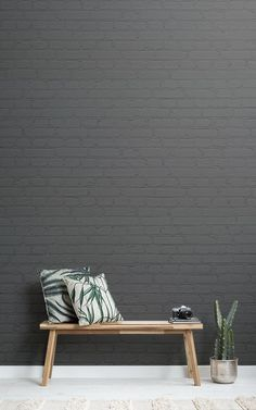 A faux black brick wallpaper is an effortlessly stylish choice & this dark brick design will keep your wall sleek & impressive.