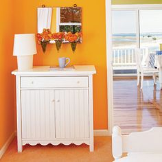 Bedroom-orange-white-furniture-These bright shades aren't for the faint of heart. Bring sunny hues into your home and celebrate summer all year. Keep it simple. Walls painted a bold citrus color allow you to decorate with just a few understated pieces.