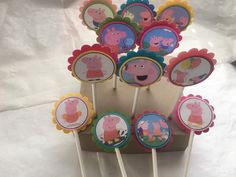 A personal favorite from my Etsy shop https://www.etsy.com/listing/288801615/just-12-peppa-pig-cupcake-toppers