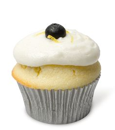 Lemonberry Sunshine – A lovely lemon essence cupcake filled with house made blueberry filling, topped with whipped lemon cream cheese frosting, zest of lemon and fresh blueberries. Light, sweet and lovely. Makes us think of mom.