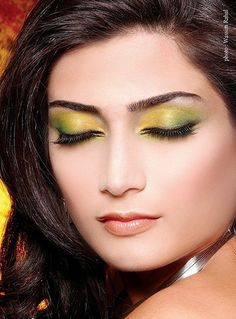 Woman with makeup in green and yellow