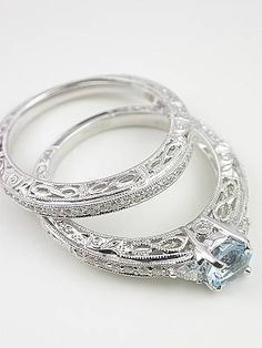 Antique Style Filigree Wedding Band and engagement ring- I'm obsessed with this type of ring in general, but this particular one is just perfect. Everything I ever imagined as a little girl. Simple center diamond with small diamonds surrounded by swirling filigree work along the sides. Dream ring for sure - and under $1, 500! #smallweddingrings #smalldiamondrings