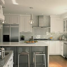 love everything about this contemporary kitchen- subway tile, cabinets, pulls, island, chairs!