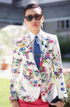 at first I thought this was PSY - Paris Fashion Week Street Style. Masculine blazer and tie, prettied up with bold floral print
