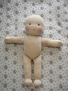Finally, bend up the foot and stitch across the top to the leg. Stab stitch the joint at the hips, and your doll body is done!