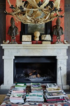 coral walls and stone fireplace. love the chandelier via Share-Design-Blog-Paul-Bangay-Stonefields-Home-Photo-Lucas-Allen-08