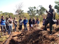 Uncle Benji explaining all about charcoal kilns to curious volunteers