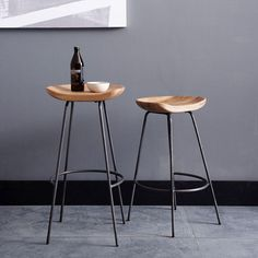 Our Alden Bar Stools pair a rustic carved wood bucket seat with an industrial raw steel base, for a modern take on the classic tractor seat that's anything but rural