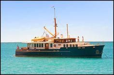 Beautiful vintage yacht,  at anchor in the Whitsundays Islands, Queensland, Australia photo: Roberto Portolese