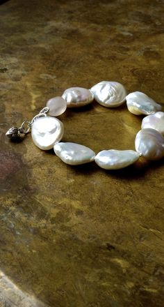 A beautiful baroque pearl statement bracelet with lotus bud charms at The Pillow Book