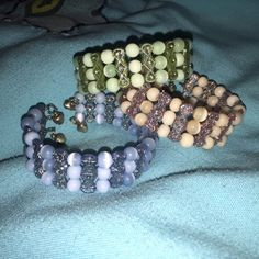 3 Jingle Bracelets 3 bracelets with bells at the end of them. Each color is 3 layers. Sold together. No trades. Jewelry Bracelets
