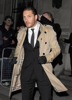 ESQUIRE's BEST DRESSED OF THE YEAR # Tom Hardy. In July, it rained at the London premiere of The Dark Knight Rises. (Obviously.) And the man who broke bad as Bane proved that not only can you wear a trench coat all year round, but you can look like this while doing it. Plus, he's wearing driving gloves. Necessary in the middle of summer? Probably not. Sharp-looking? Sharp-looking.