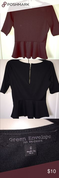 Cute top Like new worn it ones. Size small. Has a silver zipper on the back. Green envelope Tops