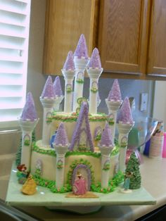 DO ROSETTE CAKES INSTEAD Princess Castle Cake! - My daughters 3rd birthday! 2 tiered cake covered in fondant and then used Wiltons Castle kit. It has over 250 mini pink rosettes. Sorry my picture is blurry.