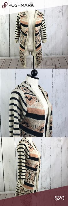 "American Rag Cie Hooded Cardigan Sweater This striped, long, Aztec print Cardigan is perfect for so many occasions! Paired with tee, denim and boots and you're fall/winter ready! 🍁 35"" Length back of neckline to hem 23"" Underarms across the front 21"" down 3/4 arm                53% cotton, 35% Nylon, 12% Acrylic Great condition with no rips, stains, etc. Reasonable offers accepted😊 Happy shopping!🌼 American Rag Sweaters Cardigans"
