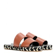 Proenza Schouler - Leather sandals - There's no denying it's the season of the summer slide, and none come cooler than Proenza Schouler's. The contrast of brown leather against a black and white woven espadrille sole creates a chic fusion that'll amp up any look. seen @ www.mytheresa.com