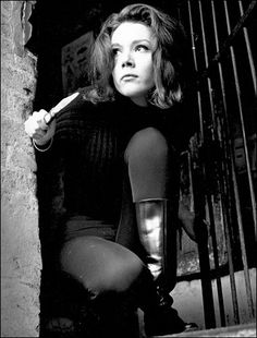 Diana Rigg as Emma Peel in the Evengers. She showed us that women could be tough... and stylish too!