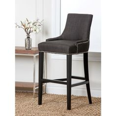 Treat your bar to an elegant makeover with these Abbyson Living Newport gray bar stools. The rich texture of the linen upholstery complements the sleek espresso legs and silver nailhead trim to create