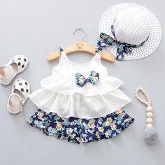 Adorable Bowknot Ruffle Sleeveless Top and Floral Shorts Hat Set for Baby Girl * Bowknot decor * Material: Cotton * Machine wash, tumble dry * Includes: 1 top, 1 bottom, 1 hat * Imported Baby Girl Frocks, Frocks For Girls, Little Girl Dresses, Girls Dresses, Baby Dresses, Long Dresses, Girls Frock Design, Baby Dress Design, Baby Frocks Designs