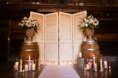 From the rustic wood stumps lining the aisle to the romantic candlelit ceremony, this wedding ceremony is one to remember! #winerywednesdays