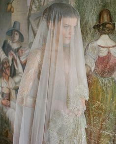 The Venice drop veil is made using Blush French silk tulle and adorned with hand sewn French Gold Metallic Eyelash lace. This gorgeous veil drapes beautifully and flows like water with its long sweeping blusher. The entire veil is hand sewn. No sewing machine is used to attach the lace.