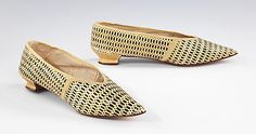 """J. Staton slippers, 1795-1805, British, Leather. Brooklyn Museum Costume Collection at The Metropolitan Museum of Art. MOMA's description: """"A particularly fine example of the stencil-printed leather, extremely pointed toe, and low heel popular around 1800, these slippers would have served to enliven a plain dress. Yellow and black was a much favored color scheme for stencil-printed shoes. This design has an interesting optical effect of yellow mesh over a black ground."""""""