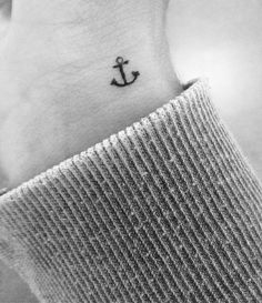 Love how simple and small this one is. Anchor tattoos.. Symbolism could be defined as, Hope, Safety, Fidelity, Stability, Security, Salvation. Can be seen symbolically as something that holds you in place and provides you the strength to hold on no matter how rough things are.