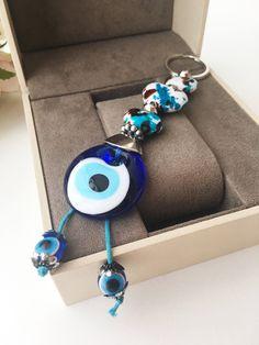 Evil eye key chain, ceramic heart charm keychain, evil eye key ring, evil eye bag charm, nazar boncuk, protection keychain, yoga keychain #accessories #keychain #blue #ceramicheartcharm #protectionkeychain #matikeyring #yogakeychain #evileye #evileyes #ke