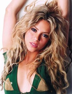 Shakira. She has a small figure (a little less than five feet), definitely a Gamine. Interestingly, her original hair color is a very deep, cool brown - and her eyes are also a cool shade of brown, but her skin has a distinct warmth. I'd say she's a Deep Winter, seriously flowing into SA though.