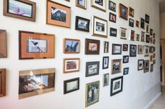 Tim's extensive gallery wall in the front hallway