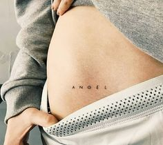 Word 'angel' inked in a minimalist font on the right hip by tattooist Cholo - < Quote & Word Tattoos > - Minimalist Tattoo Simple Angel Tattoos, Simple Tattoo Fonts, Tattoo Word Fonts, Hip Tattoo Quotes, Word Tattoos, Mini Tattoos, Tatoos, Hip Tattoo Small, Small Tats