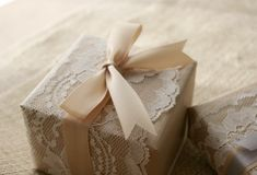 For a classic, elegant look, wrap packages in simple brown butcher paper & top with nude satin ribbon. The lace is optional.