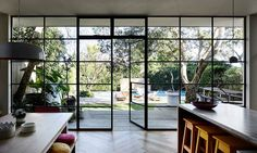 """The wall of black-steel-framed windows and doors is something Rachel was very particular about. """"The doors were custom-made in Melbourne, brought up on a truck and installed over a few days. Two things I refused to compromise on were the windows and floor Steel Windows, Windows And Doors, Wall Of Windows, Iron Windows, Bedroom Windows, Big Windows, Floor To Ceiling Windows, Iron Doors, Style At Home"""