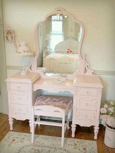 Whar a beautiful dressing table, I love the pastel pink shabby chic look, the large mirror and low backed chair...perfection