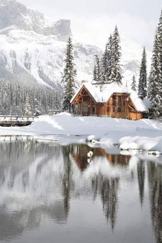 Winter snowy cabin on the lake