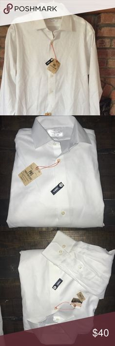 Lorenzo Uomo The Perfect White Shirt Look sharp. Look elegant. Solid white trim-fit shirt will become your go to for both work and pleasure. Added stretch for comfort, non-wrinkle fabric! Perfect for travel.  Removable collar stays Mitered, adjustable button cuffs  French Placket Spread Collar Back Yoke Cotton Machine Wash Lorenzo Uomo Shirts Dress Shirts
