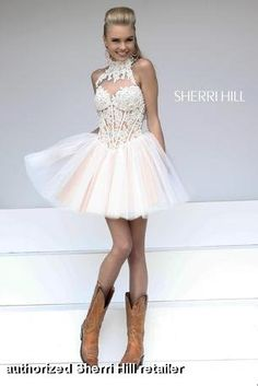 Sherri Hill 21193. This feminine short dress features a beaded lace bustier bodice. It has a sheer high neckline with a high back with a keyhole opening. The basque waist becomes a full skirt with layers of tulle. Mid zip back. Shown in Ivory / Nude. $698 @Sherri Hill #sherrihill #prom2014 #promdresses prom dresses prom dress FaceBook Pinterest