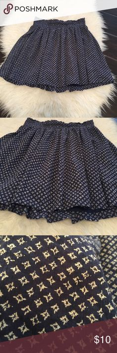 Women's a line skirt. Blue skirt.Blue a line skirt Very good used condition womens size small old navy blue and cream flare twirl skirt. Slight fading but it had a slight faded look when I bought it. Only worn a handful of times. Could fit a small medium as well, a lot of stretch in the waist. No Trades or Low Balls. Please ask any questions and review photos for details and wear. Old Navy Skirts A-Line or Full