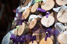 Custom cut wooden escort cards name tags at wedding, saltwater farm vineyard, purple and green ribbon