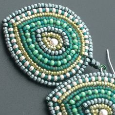 Green earrings by pardalotebeads, via Flickr