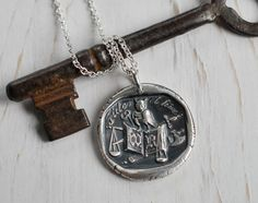 an owl a book and the scales of justice wax seal by suegrayjewelry, $75.00 I love wax seal jewelry!