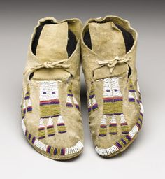 A PAIR OF ARAPAHO BEADED HIDE MOCCASINS