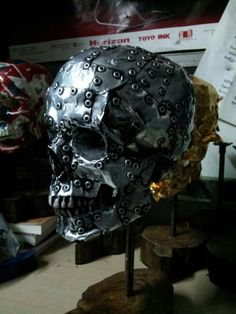 An experimental skull, from sheet metal and rivets.
