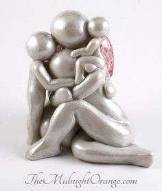 This custom made clay angel family legacy sculpture with mother, father, sibling and angel baby is a tangible way to remember a child who touched the stars too soon. This collectible is a tender keepsake whether buying personally or for someone you care about.  Size: Approximately 3.5 inches tall - see size reference in photos Customization: To see this design with different numbers of family members, please visit this link to find your family portrait…