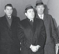 Handcuffed Joe Colombo Sr. arrives at Nassau District Attorney William Cahn's Mineola, L.I., office after his arrest