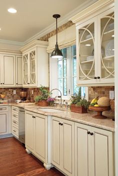I want my upper white glass cabinets to look like this and i love the molding on the top of the cabinets