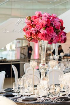 Nisie's Enchanted Florist -- Shades of red represent passion and energy, especially  in a modern and white reception hall, red roses, red and pink florals, weddings, nisies enchanted, tall centerpieces, bright pink florals, clear vases, crystal beads