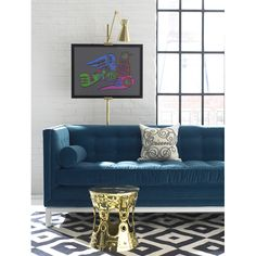 Like the intense color and combo of patterns. Brass Ulu Side Table