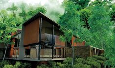 "Best Eco-Lodge: Mashpi Lodge, Ecuador. Selected for its eco cred and prime location in the Mashpi Rainforest Biodiversity Preserve. ""It runs on hydropower, has a farm for harvesting local papaya and other ingredients for meals, and will one day be majority-owned by the 80-percent-local staff,"" our reporters say. (Click through to see full list of Outside Magazine's 2012 Travel Awards.)"